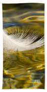 Feather On Golden Water Beach Towel