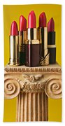 Five Red Lipstick Tubes On Pedestal Beach Towel