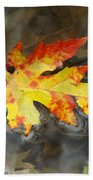 Floating Autumn Leaf Beach Towel