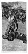 Football Injury, 1891 Beach Towel