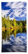 Forest And Sky Reflecting In Lake Beach Towel