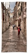 Girl In Red In The White Streets Of Dubrovnik Beach Towel