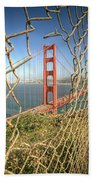 Golden Gate Through The Fence Beach Towel by Scott Norris