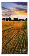 Golden Sunset Over Farm Field With Hay Bales Beach Towel
