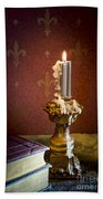 Gothic Scene With Candle And Gilt Edged Books Beach Towel