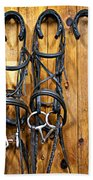 Horse Bridles Hanging In Stable Beach Towel