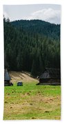 Huts In The Hills Beach Towel