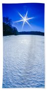 Ice And Snow Frozen Over Lake On Sunny Day Beach Towel