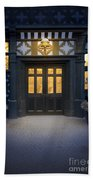 Illuminated Doorway To A Timber Framed Tudor House Or Mansion At Beach Towel