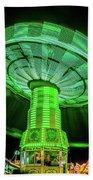 Illuminated Fair Ride With Blurred Neon Beach Sheet