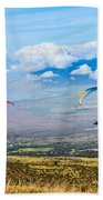 In Flight - Paragliders Taking Off High Over Maui. Beach Towel
