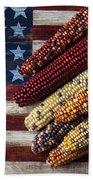Indian Corn On American Flag Beach Towel by Garry Gay