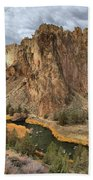 Jagged Peaks And River Reflections Beach Towel