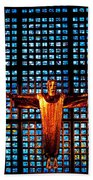 Jesus Sculpture And Blue Glass Background Beach Towel