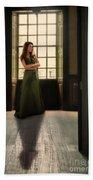 Lady In Green Gown By Window Beach Towel