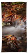 Leaves In The Creek Beach Towel