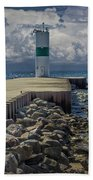 Lighthead At The End Of The Pier In Pentwater Michigan Beach Towel