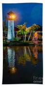 Lighthouse Reflection Beach Towel by Adrian Evans