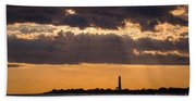 Lighthouse Sun Rays Beach Towel
