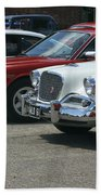A Line Up Of Vintage Cars Beach Towel