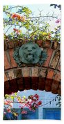 Lion Arch With Flowers Beach Towel
