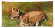 Lion Cub Running Beach Towel