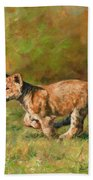 Lion Cub Running Beach Towel