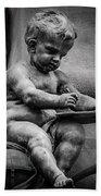 Little Boy Made Of Stone Beach Towel