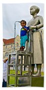 Little Girl Gets Close To Woman Sculpture In Donkin Reserve In Port Elizabeth-south Africa Beach Towel