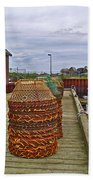 Lobster Fishing Baskets And Boats By A Dock In Forillon Np-qc Beach Towel