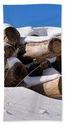 Log Pile In A Snow Drift In Winter Beach Towel