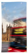 London The Uk Red Bus In Motion And Big Ben Beach Towel
