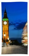 London Uk Red Bus In Motion And Big Ben At Night Beach Sheet