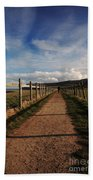 Lone Walker On The North Yorkshire Coastal Path Beach Towel