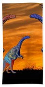 Long Necked Long Tailed Family Of Dinosaurs At Sunset Beach Towel