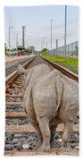 Rhino On A Railway Track Beach Towel