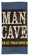 Man Cave Enter At Your Own Risk Beach Towel by Debbie DeWitt
