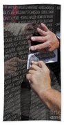 Man Getting A Rubbing Of Fallen Soldier's Name At The Vietnam War Memorial Beach Towel