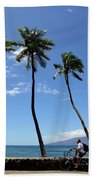 Man Riding Bicycle Beside Palm Trees Beach Towel