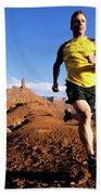 Man Running In Moab, Utah Beach Towel