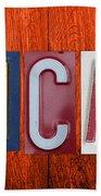 Mancave License Plate Letter Vintage Phrase Artwork On Burnt Orange Wood Beach Towel