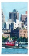 Manhattan - Tugboat Against Manhattan Skyline Beach Towel