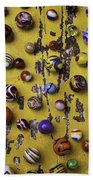 Marbles On Yellow Wooden Table Beach Towel