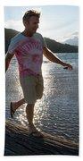 Mature Man Balances Along Log Beach Towel