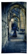 Monk In A Dark Corridor Beach Towel