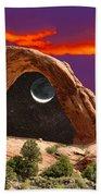 Moon In Corona Arch Beach Towel
