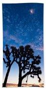 Moon Over Joshua - Joshua Trees During Sunrise In Joshua Tree National Park. Beach Towel