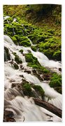 Mossy River Flowing. Beach Towel