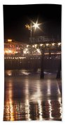 Night On Santa Monica Beach Pier With Bright Colorful Lights Reflecting On The Ocean And Sand Fine A Beach Towel