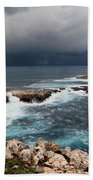 Wild Rocks At North Coast Of Minorca In Middle Of A Wild Sea With Stormy Clouds Beach Towel